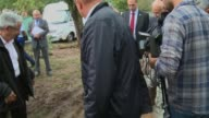 French Interior Minister Bernard Cazeneuve visits the French campsite where four people died in floods