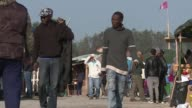 French officials fanned out across the Jungle in Calais on Sunday with flyers in several languages notifying migrants of the camp's imminent...