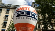 French police officers strike Officers shout and walk across Paris France and pay tribute to police officer Xavier Jugelé murdered at ChampsElysées...