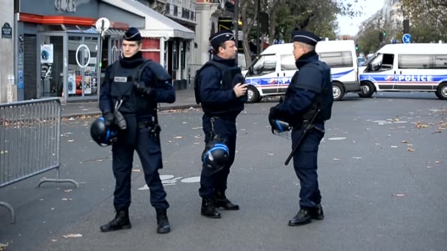 French Police stand guard at the Southern Train Station and near the Bataclan concert hall in Paris France on November 14 2015 as part of security...