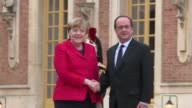 French President Francois Hollande and German Chancellor Angela Merkel arrive in Versailles as the heads of continental Europe's biggest economies...