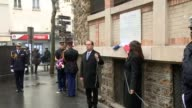 French President Francois Hollande and Paris Mayor Anne Hidalgo unveil plaques at the Belle Equipe among other bars and restaurants where gunmen from...