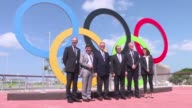 French President Francois Hollande tours the Olympic Park in Rio de Janeiro accompanied by Paris Mayor Anne Hidalgo and President of the Rio...