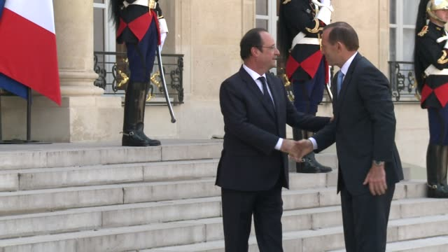 French President François Hollande welcomed the Australian Prime Minister Tony Abbott to the Elysee palace on Saturday