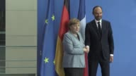 French Prime Minister Edouard Philippe and German Chancellor Angela Merkel hold a joint press conference following their talks at the Chancellery in...