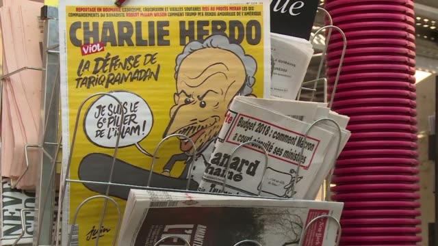 French satirical weekly Charlie Hebdo said Monday it was pressing charges after receiving fresh death threats against staffers over a cartoon of the...