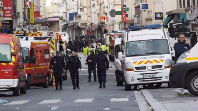 French security forces stand guard after an operation in Saint Denis a northern suburb of Paris on November 18 2015 According to officials a suicide...