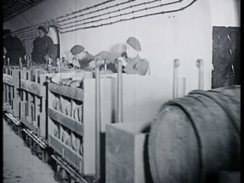 French soldiers walking down tunnel mess hall MS Ammunition train carrying barrel food supplies WS Soldiers eating in mess hall VS Soldiers eating...