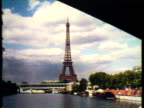 1953 WS POV French Statue of Liberty and Eiffel Tower, Notre Dame, Cafe with people enjoying coffee, The Arch of Triumph / Paris, France / AUDIO