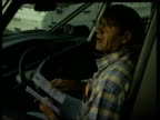 French traffic chaos ITN Driver getting out of car to talk to driver Driver sitting reading leaflets in car Driver driving along Drivers standing...