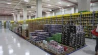 Fresh fruit and crates of beer sit on shelves at Amazoncom Inc's Amazon Prime Now fulfillment center in Singapore on Thursday July 27 Merchandise...