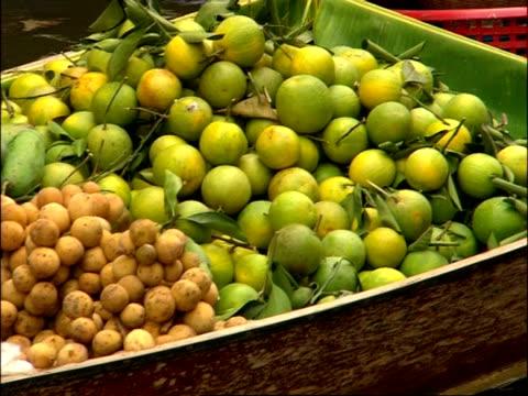 Fresh fruit on boat at Floating Market moving away from camera, Bangkok, Thailand