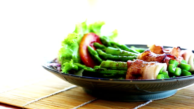 Fresh green asparagus wrapped in thick bacon.