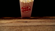 Fresh Popcorn Falling Out a Box
