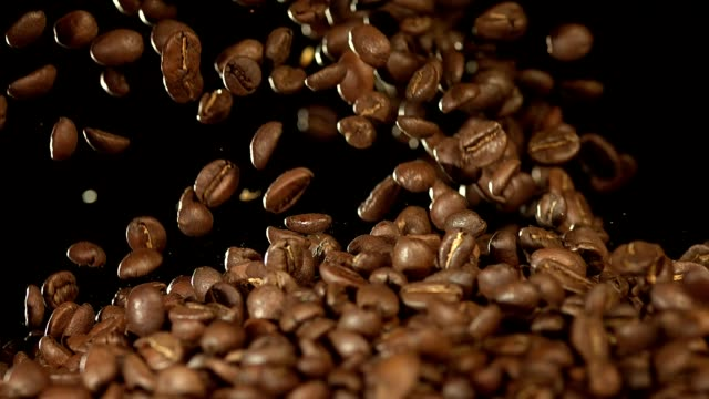 fresh roasted arabica coffee beans falling @ 1500fps closeup shot
