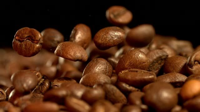 fresh roasted arabica coffee beans jumping @ 1500fps closeup shot