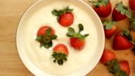 Fresh strawberries and yogurt