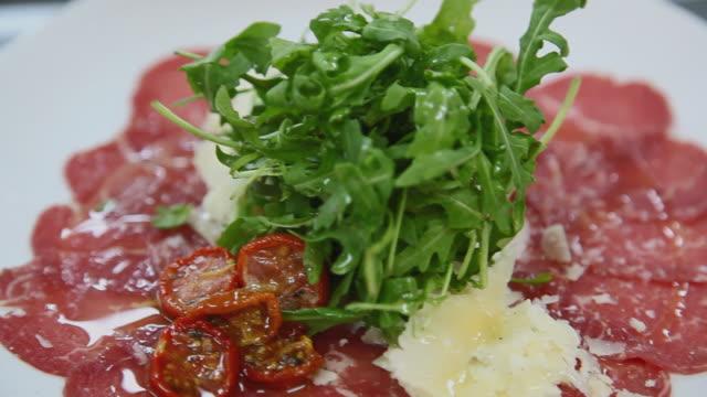 CU R/F Freshly prepared meat salad with leaf vegetable / Port de Soller, Mallorca, Baleares, Spain