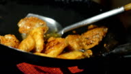 Fried Chicken is  nearly cooked in black pan