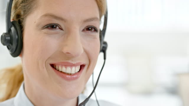 TU Friendly call center operator talking to customer