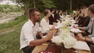 Friends and family eating at an outdoor dinner party
