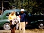 1950 friends arrive in green car