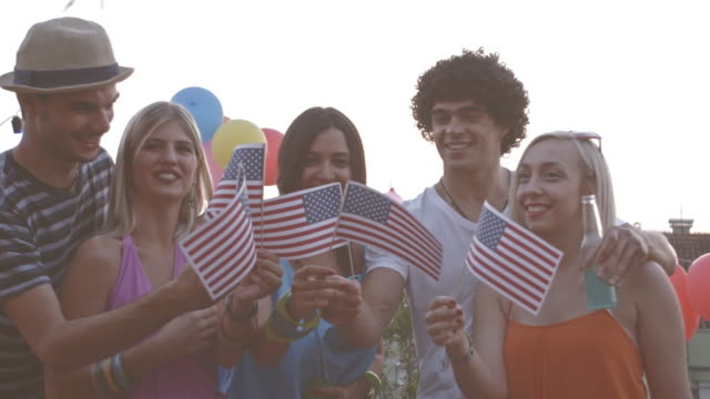 Friends cheering at fourth of July party