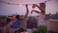 Friends dancing on urban rooftop