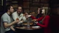 MS ZI Friends eating pizza in restaurant / Orem, Utah, USA