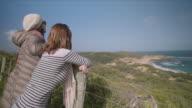 2 friends enjoying the sea views at Mornington Peninsula, Victoria, Australia