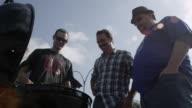 Friends gathered around a BBQ