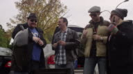 Friends having a good time at a tailgating party