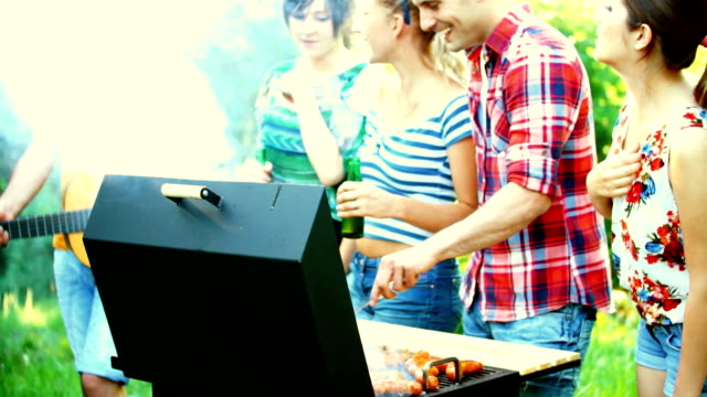 Friends having barbecue party.