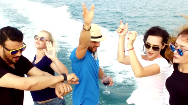 SLOW-MO: Friends having boat party