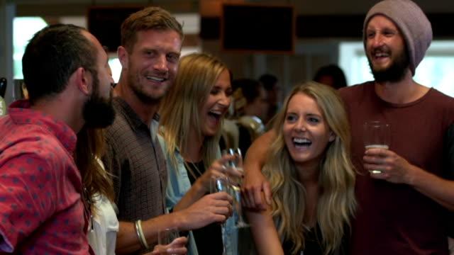 Friends having drinks in a bar