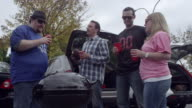 Friends having fun at a tailgating event