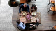 Friends having lunch in trattoria