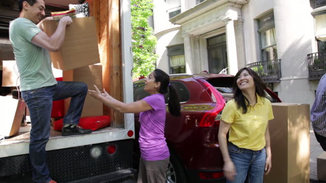 MS PAN Friends helping each other to unload moving truck / Newark, New Jersey, United States
