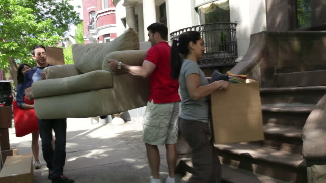 MS POV Friends helping in lifting sofa into new apartment / Newark, New Jersey, United States