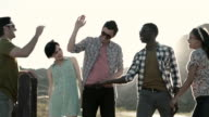 Friends high-five on a desert road trip