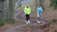 Friends Jogging up the Hills of Hexham