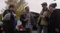 Friends joking around and toasting their beers