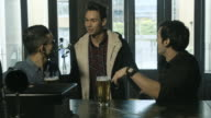 Friends meeting at the bar
