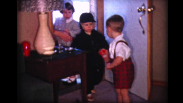 1957 friends of boy arrive for playdate