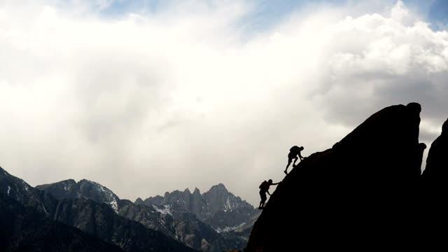 Friends out rock climbing
