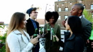 Friends party on a rooftop in New York Manhattan