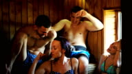 Friends relaxing in sauna