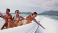 Friends riding speedboat 4K