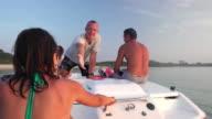 Friends riding speedboat 4K
