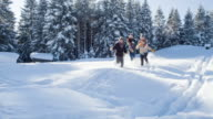 Friends running and having fun in a winter lanscape